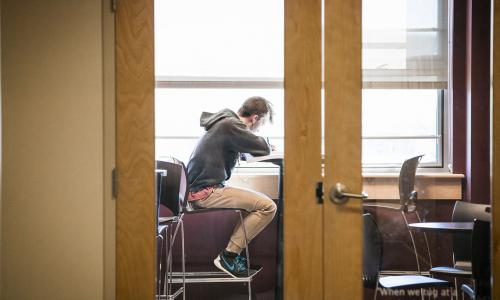 student in library studying